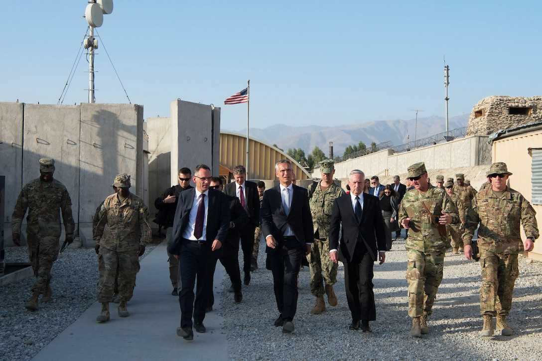 Defense Secretary Jim Mattis walks with civilian and military leaders in Afghanistan