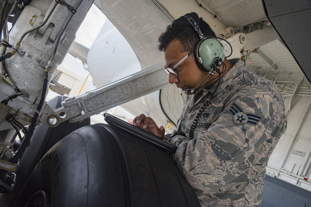 Senior Airman Jonathan Palascios-Conde, crewchief, reviews a technical order while refueling a KC-135 on the 108th Wing apron at Joint Base McGuire-Dix-Lakehurst, N.J., Sept. 20, 2017. Refueling the KC-135 is a part of the preparation that goes into prepping a jet for any mission. (U.S. Air National Guard photo by Staff Sgt. Ross A. Whitley/Released)