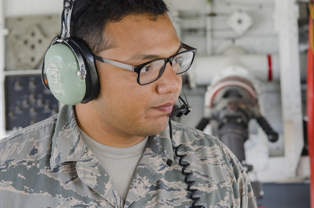 Senior Airman Jonathan Palascios-Conde, crew chief, discussing proper procedures for refueling with another crew chief while refueling a KC-135 on the 108th Wing tarmac at Joint Base McGuire-Dix-Lakehurst,N.J., Sept. 20, 2017. (U.S. Air National Guard photo by Staff Sgt. Ross A. Whitley/Released)
