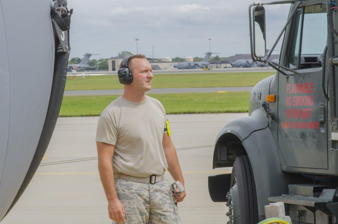 Staff Sergeant Victor Pascale, 108th Petroleum, Oils, and Lubricants shop, watches the gauges as gas is pumped into a KC-135 on the 108th Wing apron at Joint Base McGuire-Dix-Lakehurst, N.J., Sept. 20, 2017. (U.S. Air National Guard photo by Staff Sgt. Ross A. Whitley/Released)