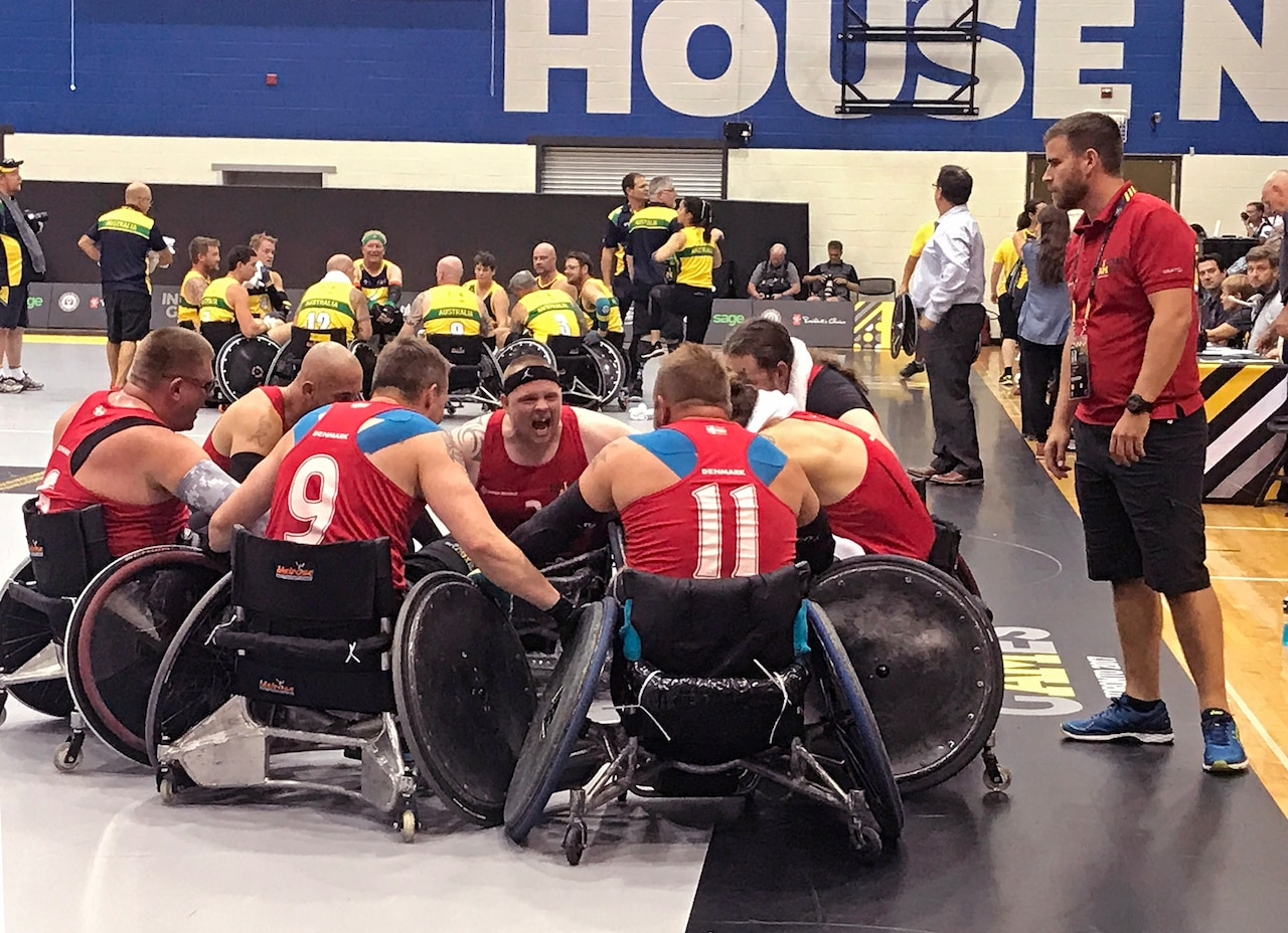 Danish team captain army Cpl. Mark Peters leads Denmark's rugby team in a victory cheer