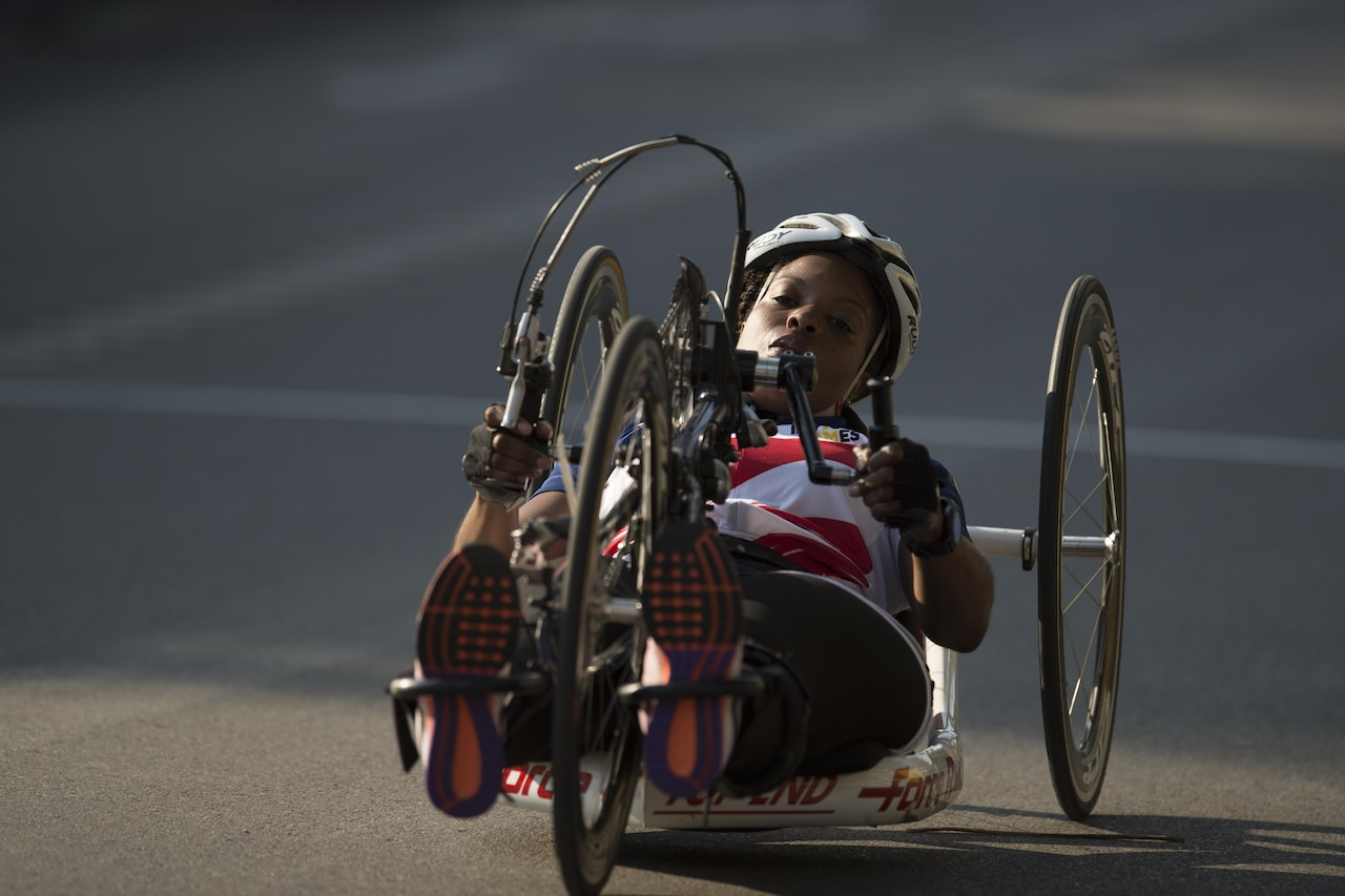 Sharona Young, a medically retired Navy chief petty officer, races a hand cycle during the 2017 Invictus Games