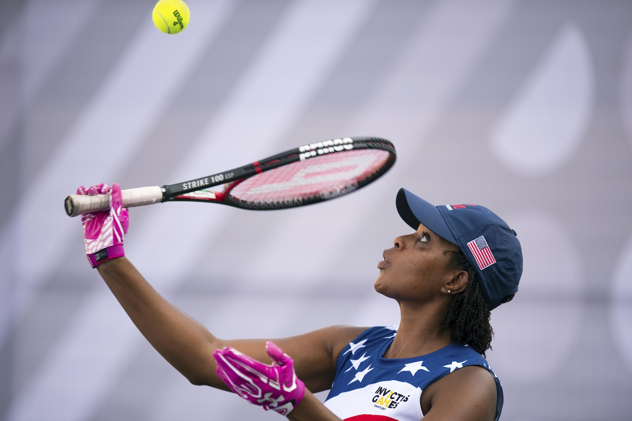 Sharona Young, a medically retired Navy chief petty officer, serves during tennis preliminaries at the 2017 Invictus Games