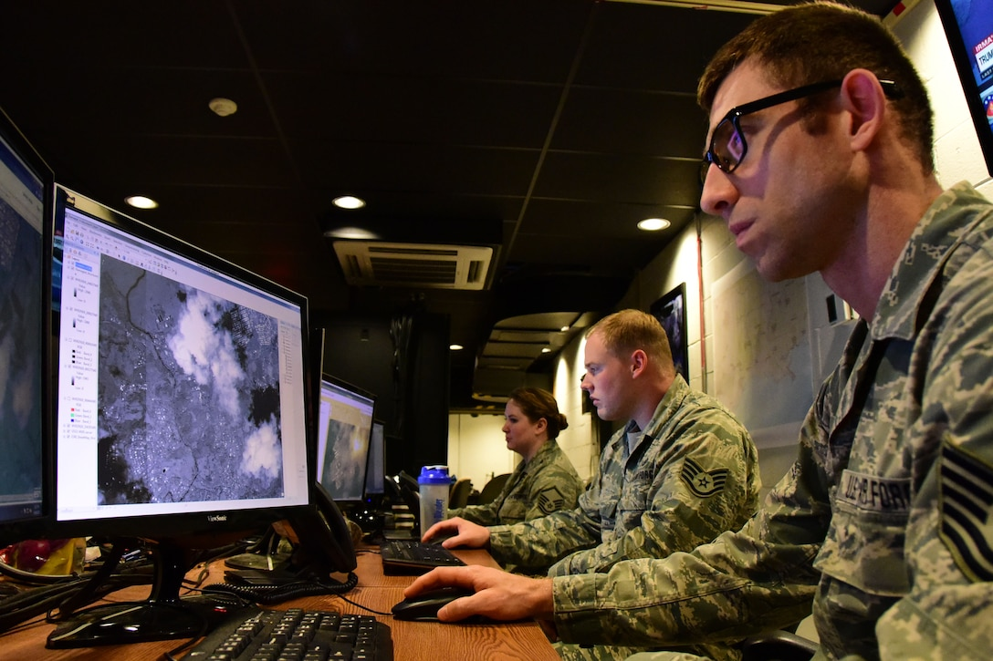 Airmen from the 118th Wing analyze damage from Hurricane Irma in the U.S. Virgin Islands from geospatial imagery on Sept. 14, 2017 at Berry Field Air National Guard Base, Nashville, Tennessee. Airmen from the 118th Wing provided valuable damage information to people working on the ground throughout the Caribbean, which helped speed up the recovery process. (U.S Air National Guard photo by Senior Airman Anthony Agosti)