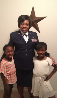 Nyla and Iyana stand with her mother, Tech. Sgt. Shonda Blanks, 375th Operations Support Squadron commander's support staff NCOIC.
