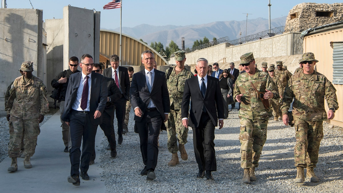 Defense Secretary James N. Mattis walks with civilian and military leaders in Afghanistan.