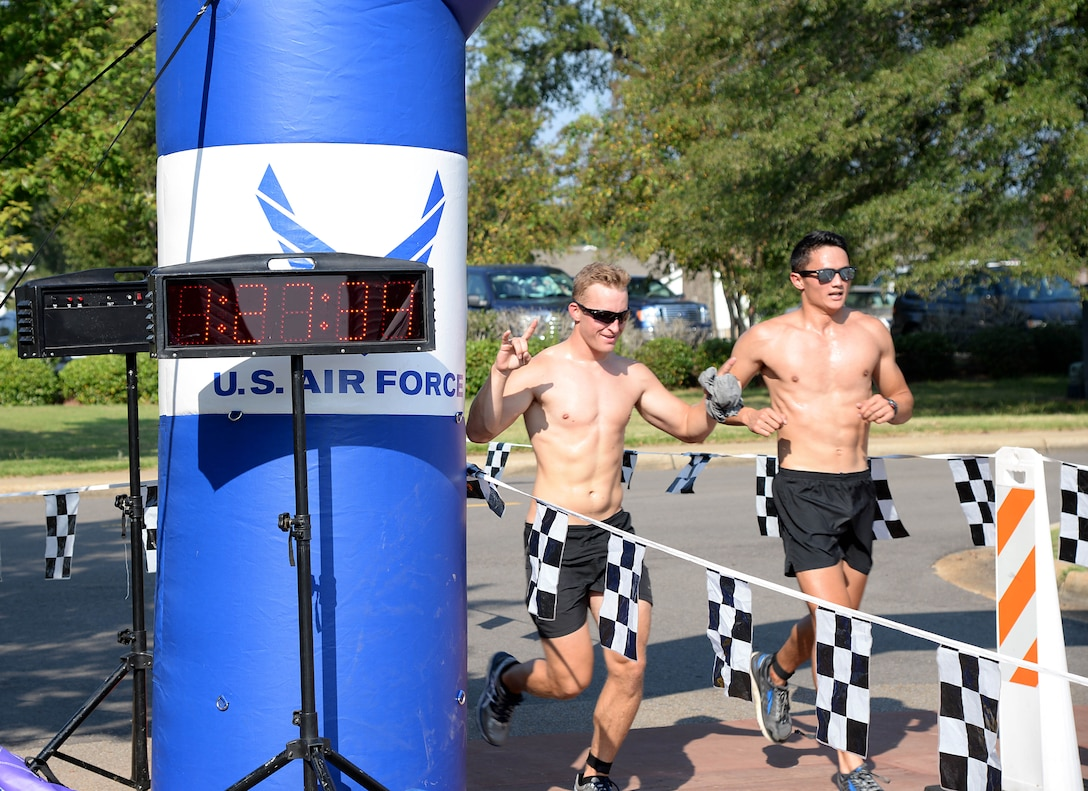 Second Lts. Dennis Cook and Forrest Schaffer, 14th Student Squadron student pilots, finish the triathlon Sept. 23, 2017, on Columbus Air Force Base, Mississippi. Some student pilots competed in pairs or groups, using the Saturday event to socialize and exercise. (U.S. Air Force photo by Airman 1st Class Keith Holcomb)