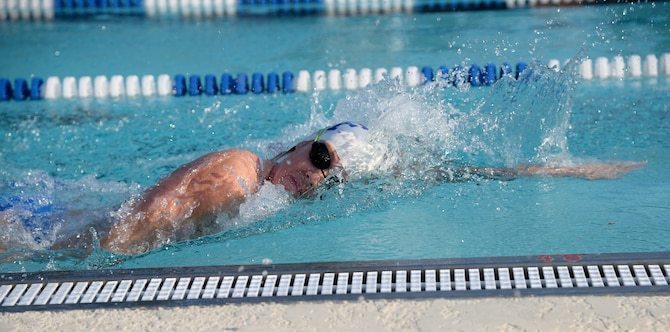 Second Lt. Brooke Cecil, 14th Comptroller Squadron Financial Services Flight Commander, begins her 300-meter swim during the base triathlon Sept. 23, 2017, on Columbus Air Force Base, Mississippi. After the 300-meter swim participants in the triathlon then biked 22 kilometers and ran a 5K. (U.S. Air Force photo by Airman 1st Class Keith Holcomb)