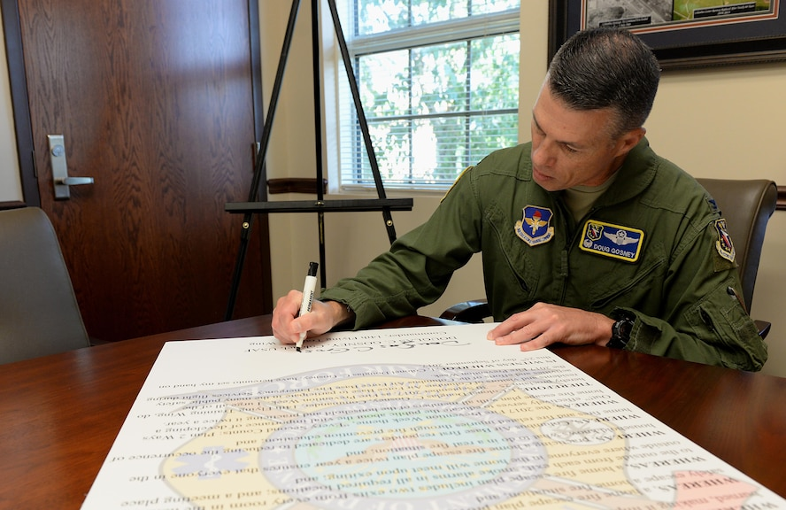 "Col. Douglas Gosney, 14th Flying Training Wing Commander, signs the Fire Prevention Week Proclamation Sept. 21, 2017, on Columbus Air Force Base, Mississippi. This year's theme is ""Every Second Counts: Plan 2 Ways Out!"" (U.S. Air Force photo by Airman 1st Class Keith Holcomb)"