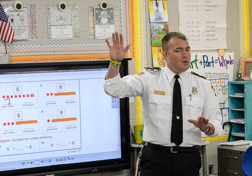 Will O'Meara, 14th Civil Engineer Squadron Health and Safety Officer, speaks to a first-grade classroom at Caledonia Elementary School Sept. 26, 2017, in Caledonia, Mississippi. Fire and emergency service members from Columbus Air Force Base, Mississippi, went to the school to bring recognition to Fire Prevention Week. The week places emphasis on a number of items such as checking fire detectors and knowing who to call in case of an emergency along with many other prevention and safety measures. (U.S. Air Force photo by Staff Sgt. Christopher Gross)
