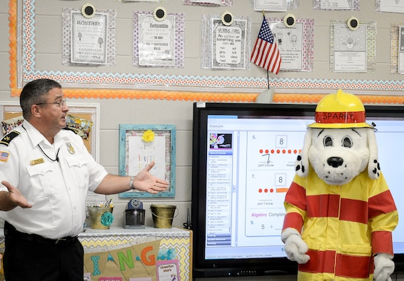 Peter J. Delillo, 14th Civil Engineer Squadron fire inspector, and Sparky the fire dog visit a first grade classroom at Caledonia Elementary School Sept. 26, 2017, in Caledonia, Mississippi. Fire and emergency service members from Columbus Air Force Base, Mississippi, went classroom to classroom at the elementary school and talked to students about the importance of having an evacuation plan and knowing their addresses amongst other things. (U.S. Air Force photo by Staff Sgt. Christopher Gross)