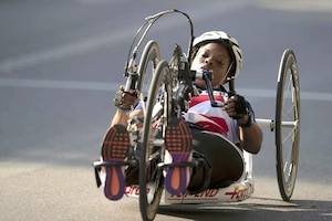 An athlete races a hand cycle.
