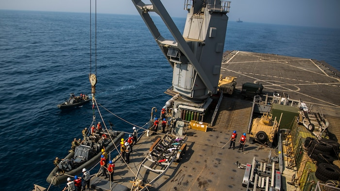U.S. 5th FLEET AREA OF OPERATIONS (Sept. 23, 2017) – Sailors aboard the amphibious dock landing ship USS Pearl Harbor (LSD 52) load a Rigid Hull Inflatable Boat (RHIB) onto the ship after conducting a personnel transfer mission.  The 15th Marine Expeditionary Unit is embarked on the America Amphibious Ready Group and is deployed to maintain regional security in the U.S. 5th Fleet area of operations. (U.S. Marine Corps photo by Cpl. F. Cordoba)