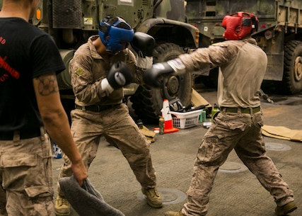 U.S. 5th FLEET AREA OF OPERATIONS (Sept. 22, 2017) – Cpl. Santiago Garces and Cpl. Rigger Velasquez both Light Armored Reconnaissance vehicle crewmen with 1st Battalion, 5th Marine Regiment, the 15th Marine Expeditionary Unit's Battalion Landing Team spar during a green belt course part of the Marine Corps Martial Arts Program aboard the amphibious dock landing ship USS Pearl Harbor (LSD 52).  The 15th Marine Expeditionary Unit is embarked on the America Amphibious Ready Group and is deployed to maintain regional security in the U.S. 5th Fleet area of operations. (U.S. Marine Corps photo by Cpl. F. Cordoba)