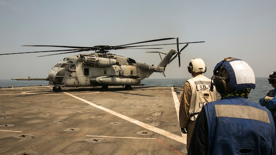 U.S. 5th FLEET AREA OF OPERATIONS (Sept. 21, 2017) – A CH-53E Super Stallion helicopter prepares to depart the amphibious dock landing ship USS Pearl Harbor (LSD 52) after picking personnel up for a transport mission. The 15th Marine Expeditionary Unit is embarked on the America Amphibious Ready Group and is deployed to maintain regional security in the U.S. 5th Fleet area of operations. (U.S. Marine Corps photo by Cpl. F. Cordoba)