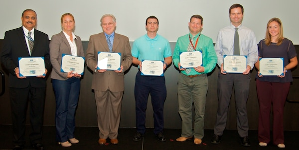IMAGE: DAHLGREN, Va. - Ajoy Muralidhar, Kathleen Jones, William Catoe, David Fredrickson, David Shuttleworth, Joseph Carter, and Jessica Hildebrand, (l to r), are pictured with their certificates of achievement at the 2017 Naval Surface Warfare Center Dahlgren Division (NSWCDD) academic awards ceremony. The government civilians were among 13 employees selected for the fiscal year 2018 Academic Fellowship Program. The competitive program accelerates academic and professional growth of employees and contributes to the increase in degrees awarded at Dahlgren. This year, nine of the selected employees are progressing in their master's degree programs in fields of study that include cyber security engineering, business administration, systems engineering, engineering management, and computer science. One selected employee is working on a bachelor's degree in physics through the program. The command's academic fellowship program is also helping three engineers complete doctoral degree programs - one in electrical engineering, another in engineering management and systems engineering, and the third in modeling and simulation.