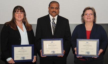 IMAGE: DAHLGREN, Va. - Cheryl Subacius, Ajoy Muralidhar, and Kathy Clark, (l to r), are pictured with their certificates of achievement at the 2017 Naval Surface Warfare Center Dahlgren Division (NSWCDD) academic awards ceremony. Subacius was recognized for completing her defense financial manager certification from the American Society of Military Comptrollers. Muralidhar was recognized for completing his graduate certificate in mission analysis and engineering from Old Dominion University. Clark was recognized for completing her defense financial manager certification from the American Society of Military Comptrollers.