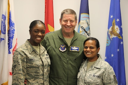 Gen. Rand poses for a photo with two NSWC Crane employees, SrA Cherelle Hines (left) and TSgt Anjuli Smith (right), following his all-hands presentation.