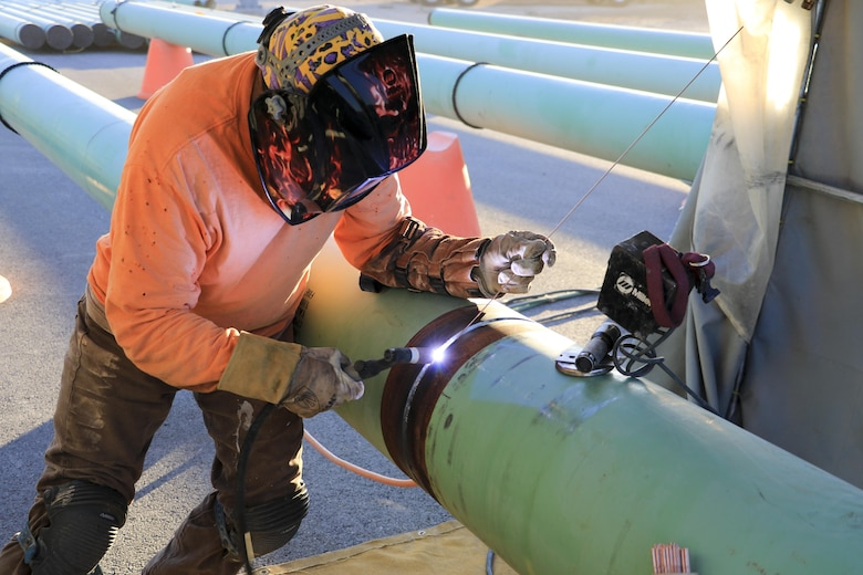 Upgrades to the refueling system at Nellis Air Force Base, Nevada, will increase the pumping capacity to 2,400 gallons per minute for 25 multi-aircraft revetments and six bomber outlets. Two new 420,000 gallon aboveground operating storage tanks will feed the system. During the hot summer months, nearly around the clock construction is overseen by the U.S. Army Corps of Engineers Los Angeles District's Las Vegas Resident Office.
