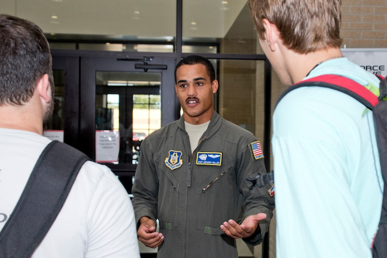 U.S. Air Force Reserve Staff Sgt. Anthony Miller, a loadmaster assigned to the 327th Airlift Squadron, 913th Airlift Group, speaks with potential recruits during the annual Cabot College and Career Fair at Cabot High School in Cabot, Ark., Sept. 28, 2017. More than 65 colleges, technical and vocational representatives and with military recruiters were on hand to answer questions for the juniors and seniors who attend the event. (U.S. Air Force photo by Master Sgt. Jeff Walston/Released)