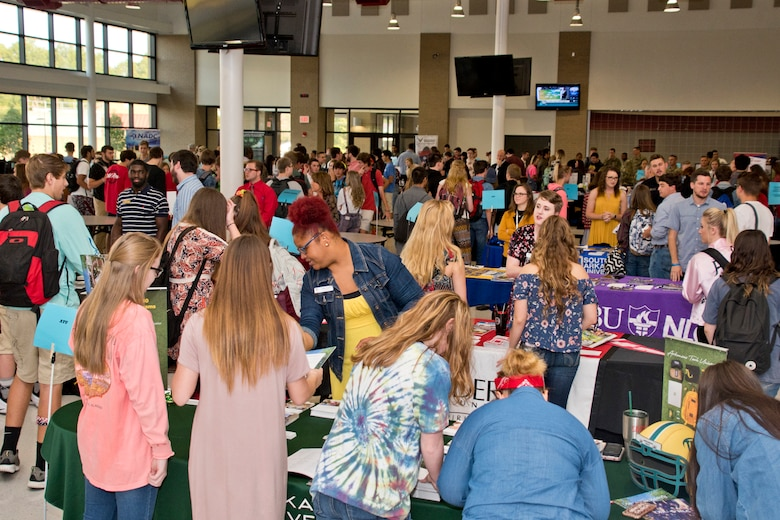 High school students gather information for future careers during the annual Cabot College and Career Fair at Cabot High School in Cabot, Ark., Sept. 28, 2017. Career Fairs allow students to converse with potential future employers and start considering career paths. (U.S. Air Force photo by Master Sgt. Jeff Walston/Released)
