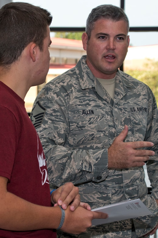 U.S. Air Force Reserve Master Sgt. Mark Allen, program manager for the 913th Airlift Group's Development Training Flight, speaks with a potential recruit during the annual Cabot College and Career Fair at Cabot High School in Cabot, Ark., Sept. 28, 2017. Approximately 1,000 juniors and seniors spoke with representatives of local colleges, technical and vocational schools along with military recruiters at the event. (U.S. Air Force photo by Master Sgt. Jeff Walston/Released)