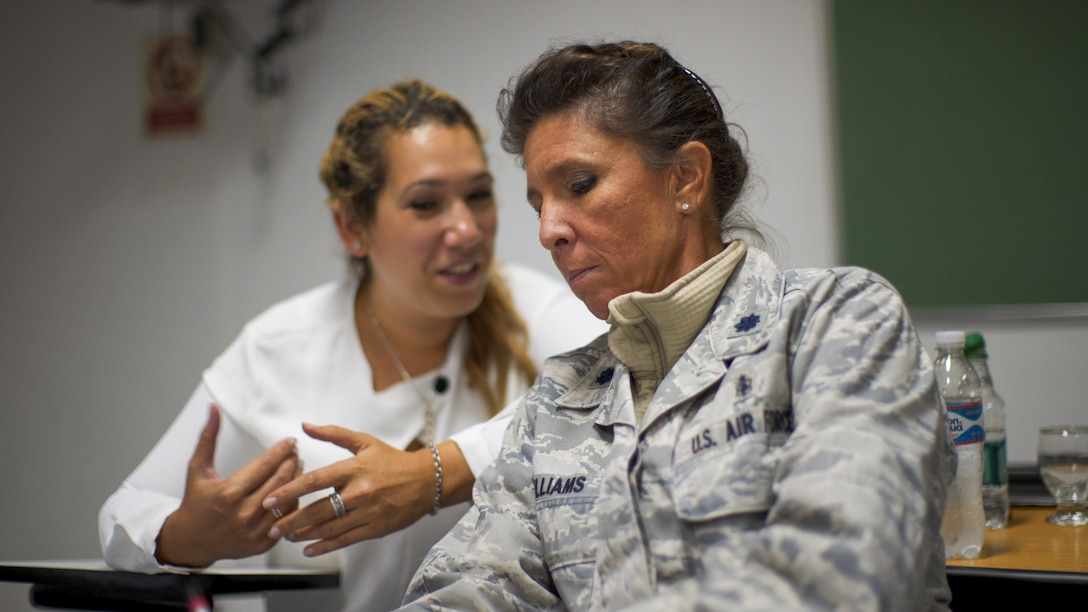 U.S. Air Force Lt. Col. Kellie Williams, 12th Air Force (AFSOUTH) Deputy Command Surgeon, speaks with an Argentinian counterpart during a senior leader engagement as part of the Department of Defense State Partnership Program Sep. 20 at the National Institute of Aeronautical and Space Medicine, Argentina.