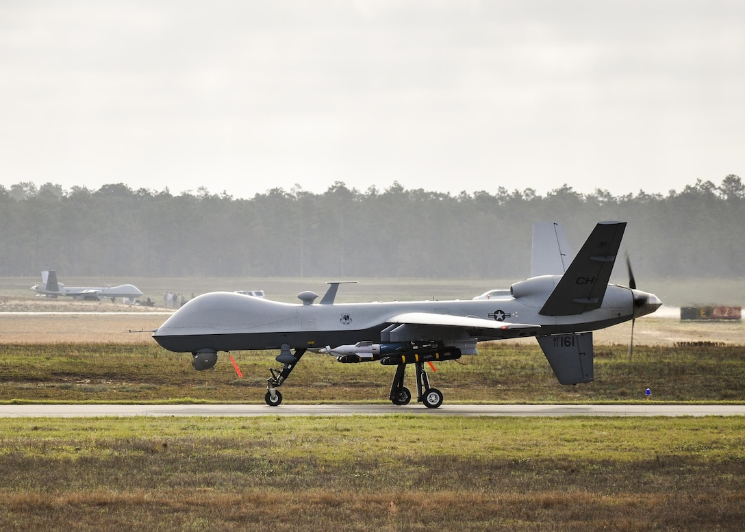 An MQ-9 Reaper remotely piloted aircraft prepares to take off