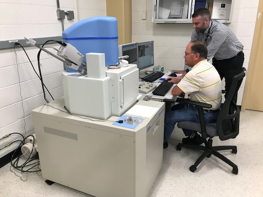 AFRL Materials Integrity researchers review microscopic images