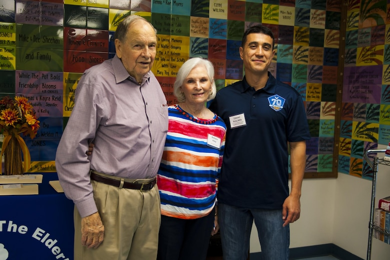 Morgan Riley, volunteer, Barbara Riley, vocational services director, and U.S. Air Force Col. Ricky Mills, 17th Training Wing commander, pose for a photo at the Meals for the Elderly center San Angelo, Texas, Sept. 27, 2017. From the organization's website, Meals for the Elderly is a private, non-profit charitable organization devoted to serving the homebound elderly of San Angelo, Texas and surrounding areas with one hot, nutritious, home-delivered meal each weekday, while also ensuring their individual well-being through personal contact. (U.S. Air Force photo by Senior Airman Scott Jackson/Released