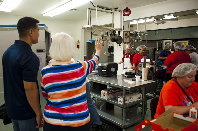 Barbara Riley, vocational services director, gives U.S. Air Force Col. Ricky Mills, 17th Training Wing commander, a tour of the Meals for the Elderly kitchen San Angelo, Texas, Sept. 27, 2017. Meals for the Elderly is a private, non-profit charitable organization devoted to serving the homebound elderly of San Angelo by delivering a warm meal to those enrolled in the program. (U.S. Air Force photo by Senior Airman Scott Jackson/Released)