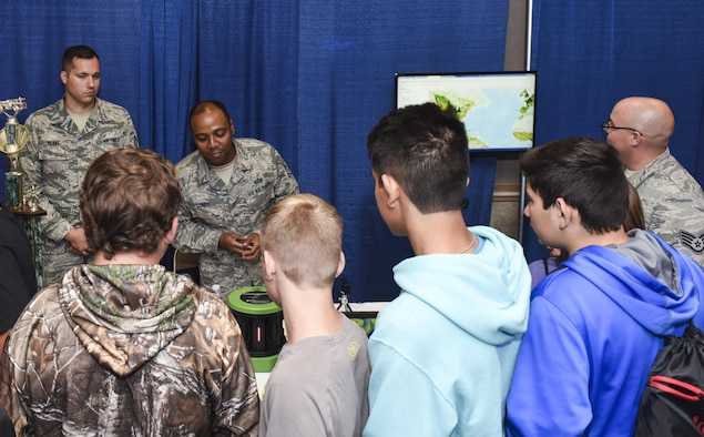 U.S. Air Force Staff Sgt. Ernest Coney, 312th Training Squadron instructor, explains to a group of Sterling City eighth graders how the seismometer measures vibrations in the earth during the Annual Business expo at the McNease Convention Center in San Angelo, Texas, Sept. 27, 2017. Goodfellow Air Force Base provided representatives from the fire academy and the 312th TRS to speak to students about potential career fields in the Air Force. (U.S. Air Force photo by Aryn Lockhart/Released)