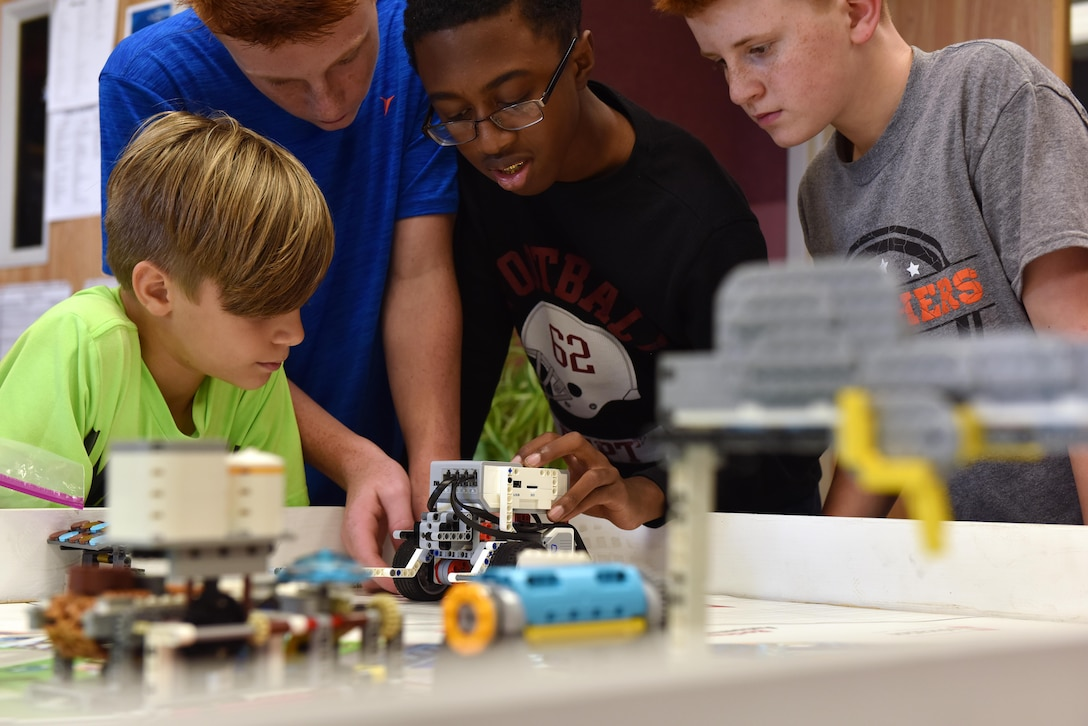 Members of Whiteman's FIRST® LEGO® robotics team practice clearing course objectives and course movements at Whiteman Air Force Base, Mo., Sept. 21, 2017.