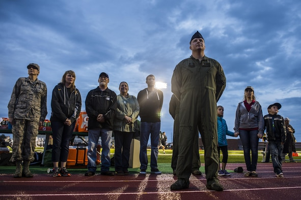 Tech. Sgt. Michael Farthing, 16th Special Operations Squadron aerial gunner on the AC-130W Stinger II, waits with family and friends to be presented his service dog before the start of the Eastern New Mexico University's Greyhounds football game September 23, 2017, at Al Whitehead Field in Portales, New Mexico. Farthing has deployed more than 10 times, has more than 270 combat mission totaling 1400 combat hours all while facing the threat of man portable air defense systems and anti-aircraft artillery. (U.S. Air Force photo by Senior Airman Luke Kitterman/Released)