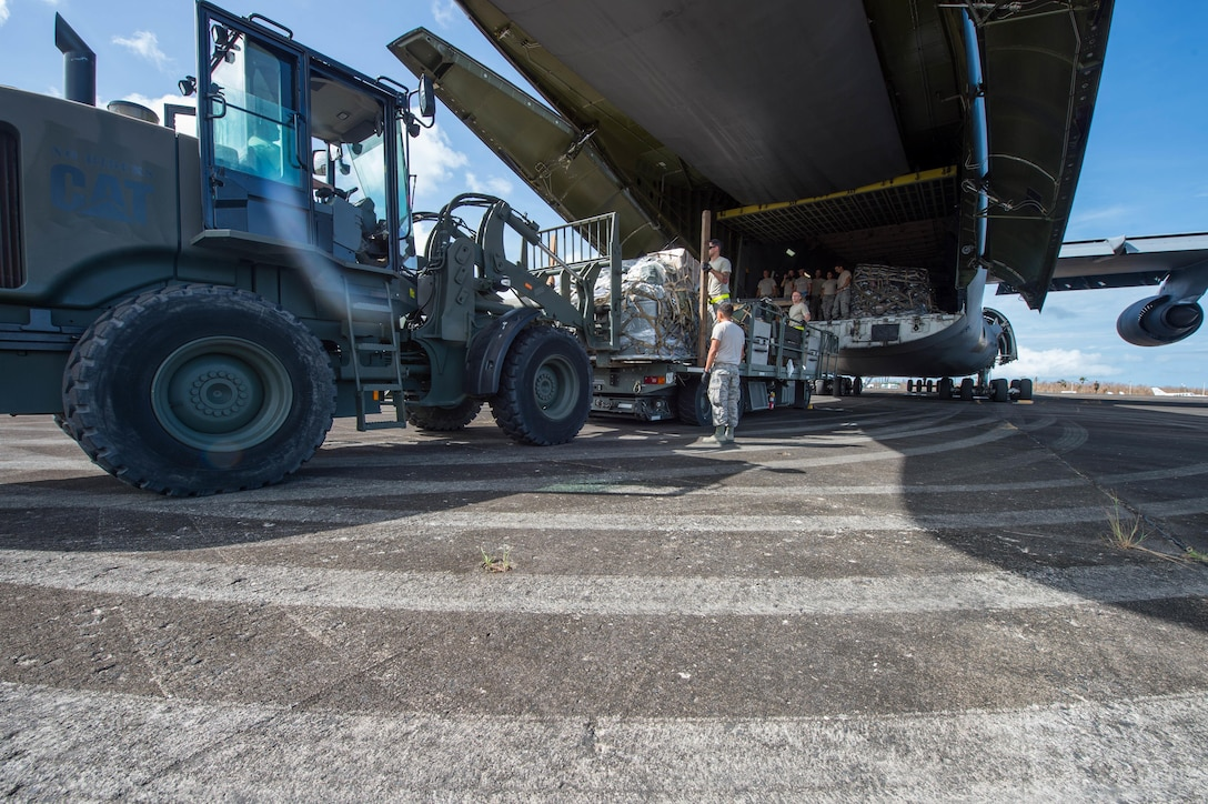 The 821st Contingency Response Group equipment is offloaded from a C-5M Super Galaxy from Travis Air Force Base Calif., at Roosevelt Roads, Puerto Rico, Sept. 25, 2017. A 70 member contingency response element from the 821st Contingency Response Group stationed at Travis Air Force Base, Calif., deployed to Puerto Rico in support of Hurricane Maria relief efforts. (U.S. Air Force photo by Staff Sgt. Robert Hicks)