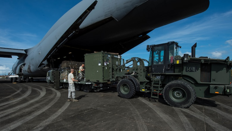 The 821st Contingency Response Group equipment is offloaded from a C-17 Globemaster lll from Travis Air Force Base Calif., at Roosevelt Roads, Puerto Rico, Sept. 26, 2017. A 70 member contingency response element from the 821st Contingency Response Group stationed at Travis Air Force Base, Calif., deployed to Puerto Rico in support of Hurricane Maria relief efforts. (U.S. Air Force photo by Staff Sgt. Robert Hicks)
