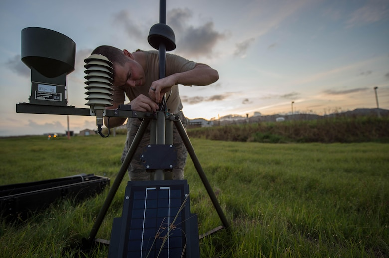 Tech. Sgt. Brian Thompkins, 921st Contingency Response Squadron weather forecaster, sets up a Tactical Airfield Weather Center at Roosevelt Roads, Puerto Rico, Sept. 25, 2017. A 70 member contingency response element from the 821st Contingency Response Group stationed at Travis Air Force Base, Calif., deployed to Puerto Rico in support of Hurricane Maria relief efforts. (U.S. Air Force photo by Staff Sgt. Robert Hicks)