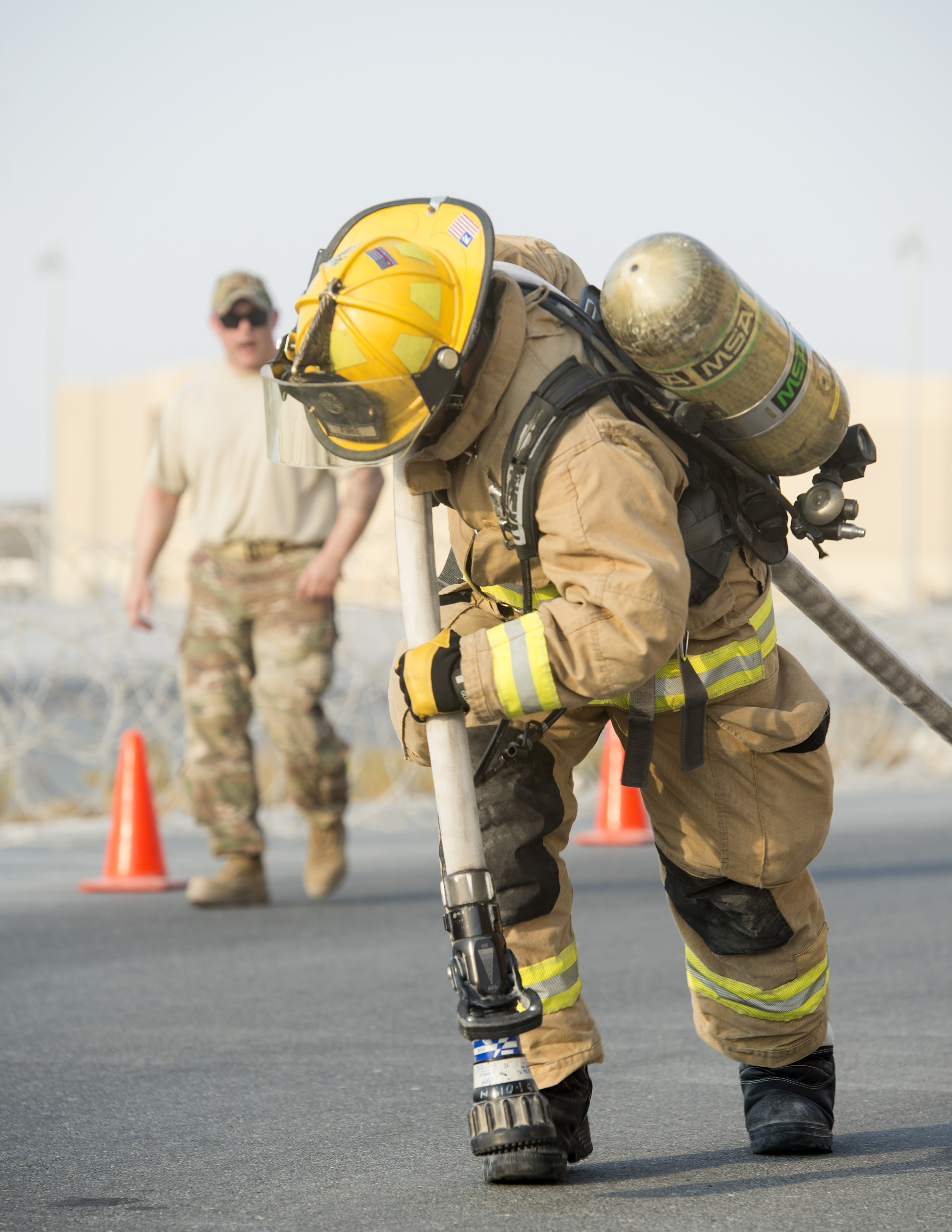 Firefighters with the U S  Air Force and Qatar Emiri Air
