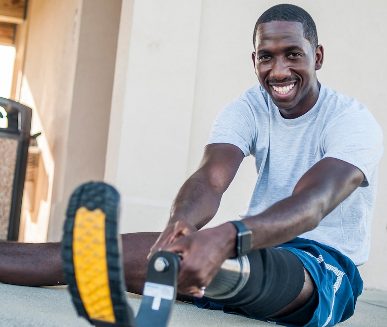 Senior Airman Kevin Greene, a health care management technician with the 920th Aeromedical Staging Squadron at Patrick Air Force Base, Florida, stretches after a short workout. Despite losing a portion of his left leg in a motorcycle accident on Dec. 17, 2014, Greene is back serving in the Air Force Reserve. (Staff Sgt. Jared Trimarchi)