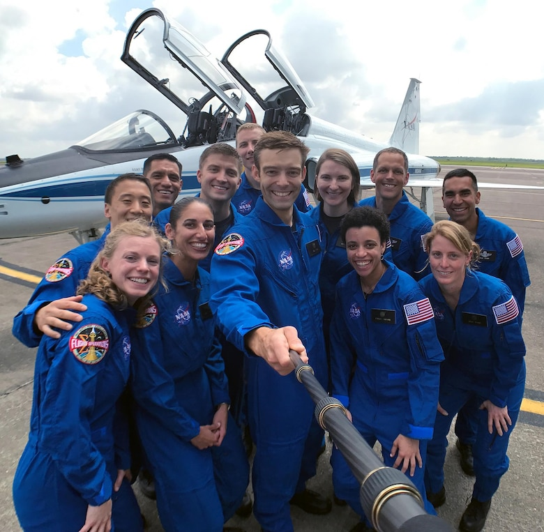 The 12 selected for the 2017 astronaut candidate class take a group photo while getting fitted for flight suits at Ellington Field near NASA's Johnson Space Center. (Photo courtesy of NASA)