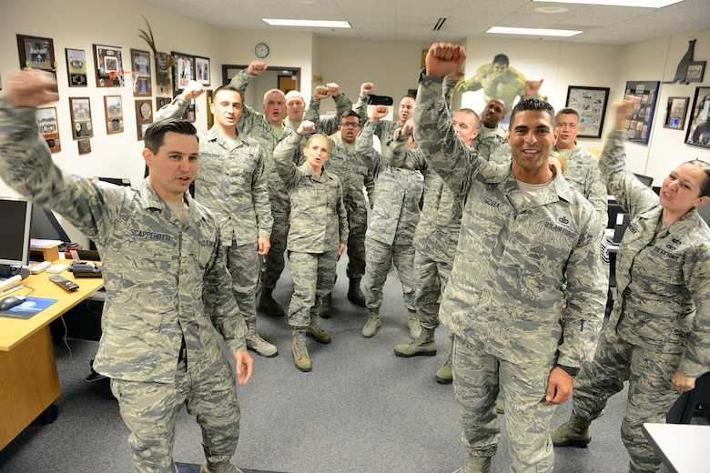 "Senior Master Sgt. James Scapperotti (front left), senior instructor at the Air Force Reserve Recruiting School, Joint Base San Antonio-Randolph, Texas, and instructor Master Sgt. Geovanni Govea (front right) lead class members in the recruiting chant, ""Boy am I enthusiastic,"" at the beginning of another day. (Master Sgt. Chance Babin)"