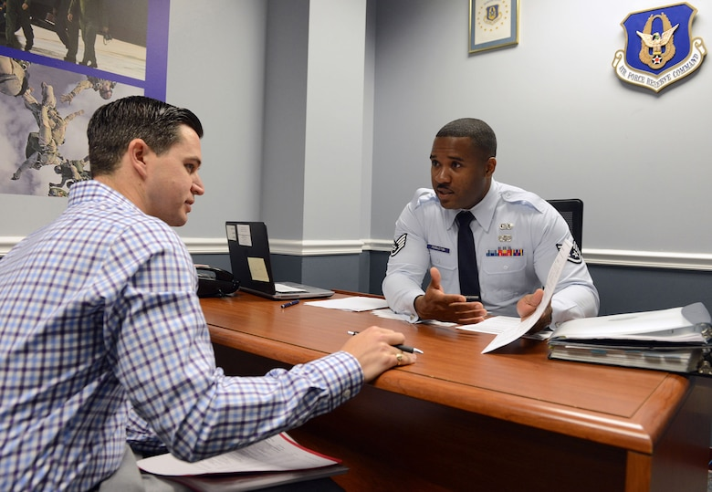 Scapperotti is dressed in civilian clothes as he plays the role of a potential recruit while being interviewed by Staff Sgt. Brandon Pendleton, a student at the recruiting school who is assigned to the 910th Airlift Wing at Youngstown Air Reserve Base, Ohio. The sales lab is used to evaluate students' ability to conduct interviews, complete forms correctly and address applicants' concerns. (Master Sgt. Chance Babin)