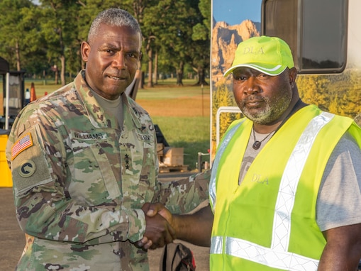Lamar Buford, DLA Distribution Red River Expeditionary Team's division chief (right) meets DLA director, Army Lt. Gen. Darrell Williams at Maxwell Air Force Base, Alabama.