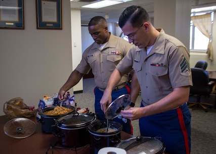 Sergeant Matthew W. Rodas, personnel chief with 6th Marine Corps District (6MCD), right, and Staff Sgt. Wi McMullen, comptroller chief with 6MCD, left, set up the chili cook-off during Mission Day at the 6MCD Headquarters aboard Marine Corps Recruit Depot Parris Island, South Carolina, Sept. 27, 2017. Mission Day commemorates the hard work and dedication of the Marines, Sailors, and civilians of 6MCD. (U.S. Marine Corps photo by Lance Cpl. Jack A. E. Rigsby)
