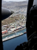 View from inside a U.S. Army helicopter as it flies over Roseau, Dominica.