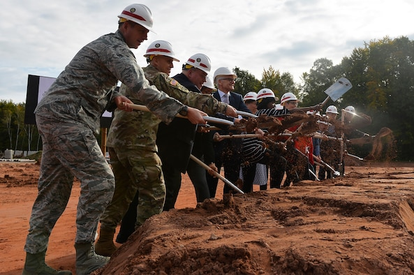 Military and civilian officials participate in a groundbreaking ceremony for a school building on Vogelweh Military Complex, Germany, Sept. 29, 2017. The U.S. Department of Defense Education Activity is pushing an initiative to establish more student-centered and energy efficient schools. (U.S. Air Force photo by Airman 1st Class Joshua Magbanua)