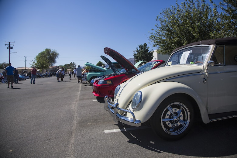 Twentynine Palms Parks and Recreation holds the first car show at Lucky Park, Twentynine Palms, Calif., September 23, 2017. Marines from motor transportation, military police and explosive ordnance disposal came out to help the continuing effort to foster a positive relationship with the community by showing what resources the military has to offer. (Marine Corps photo by Pfc. Margaret Gale)