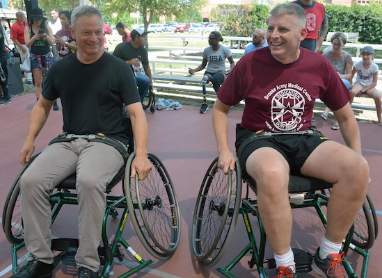 Gary Sinise and Brooke Army Medical Center Commanding General Brig. Gen. Jeffrey Johnson get ready for a wheelchair basketball game Sept. 15, 2017 at the Center for the Intrepid. Sinise and celebrity chef Robert Irvine returned to Brooke Army Medical Center for the fifth time to host the Invincible Spirit Festival. BAMC staff, patients and family members enjoyed food, music and activities throughout the afternoon.