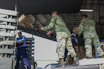 A member of the Mexican army transfers a box of hygiene supplies from a U.S. Air Force C-17 Globemaster III to a supply truck Sept. 22 at Ixetepec Airport, Oaxaca, Mexico. At the request of the Mexican government, the C-17 and its six-member crew from Travis Air Force Base, Calif., assisted U.S. efforts to provide humanitarian aid to Mexico by airlifting over 31,000 pounds of hygiene and medical supplies to the area after a 7.1-magnitude earthquake struck Mexico City Sept. 19. (U.S. Air Force photo / 2nd Lt. Sarah Johnson)