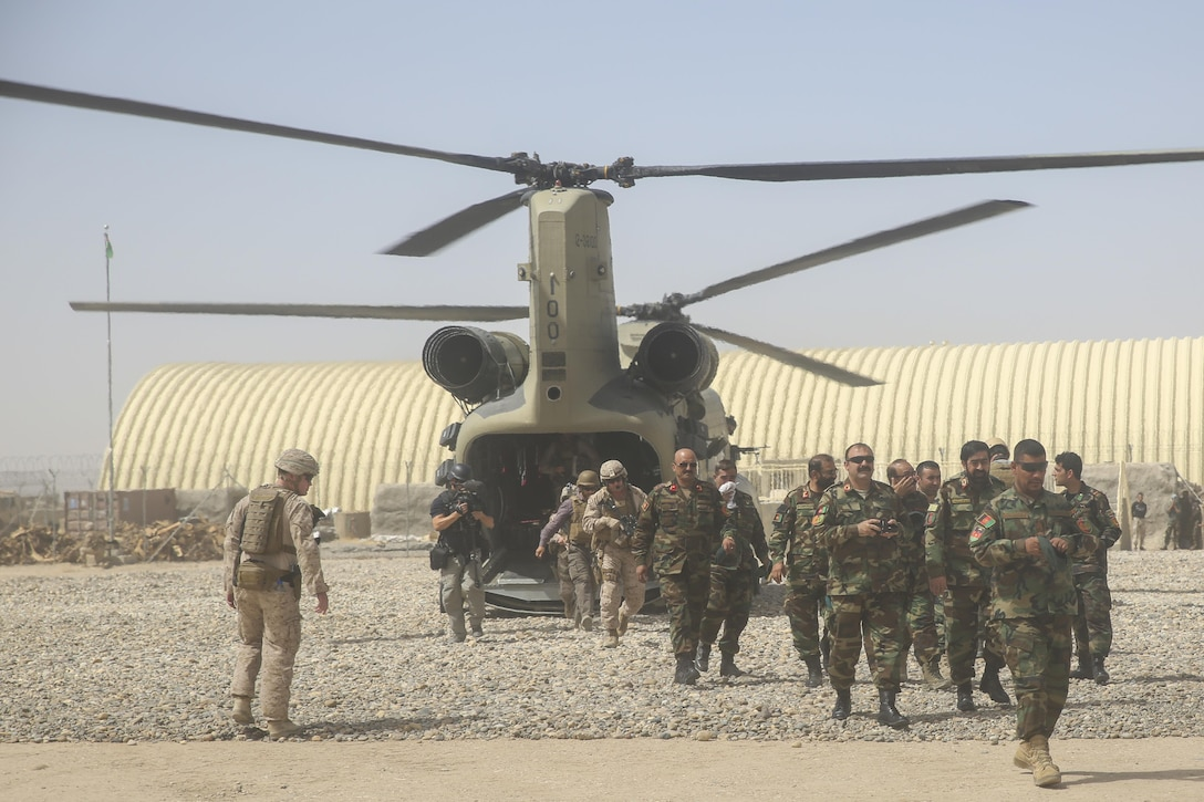 Afghan National Army soldiers with 215th Corps and U.S. Marines with Task Force Southwest disembark a CH-47 Chinook during Operation Maiwand Six near Gereshk, Afghanistan, Sept. 25, 2017. Key leaders from both forces met to discuss recent progress and develop plans for the mission. Maiwand Six combines multiple elements of the Afghan National Defense and Security Forces with advising and assistance from the Task Force, and is designed to bolster security in Gereshk and surrounding areas. (U.S. Marine Corps photos by Sgt. Lucas Hopkins)